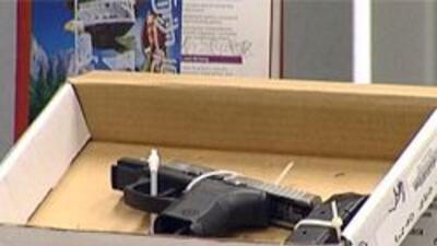 Arma confiscada en redadas