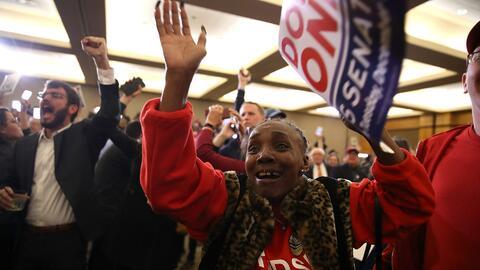 Supporters of democratic U.S. Senator candidate Doug Jones celebrate as...