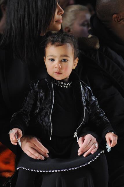 Kim Kardashian (L) and North West attend the Alexander Wang Fashion Show...