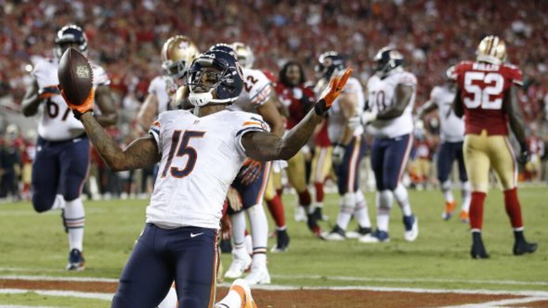 Brandon Marshall atrapó tres pases de touchdown en la sorpresiva victori...