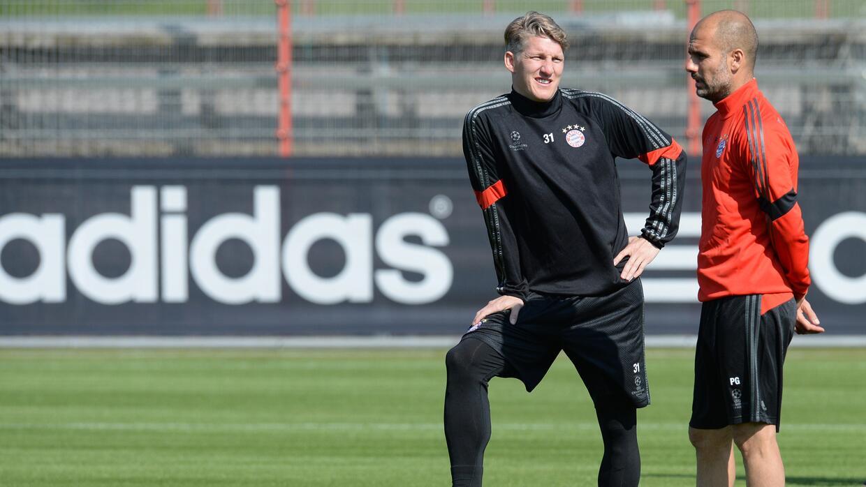 Bastian Schweinsteiger y Pep Guardiola en un entrenamiento con el Bayern.