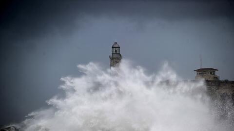 A huge wave breaks near the Morro Castle in Havana, Cuba, on Sunday, Se...