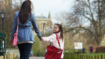 Mother Walking Daughter To School Along Path