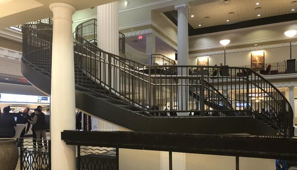 Staircase that leads up to the bar