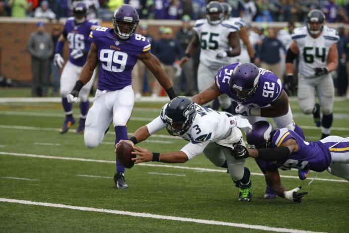Rusell Wilson brilló en el juego que los Seahawks ganaron 38-7 a los Vik...