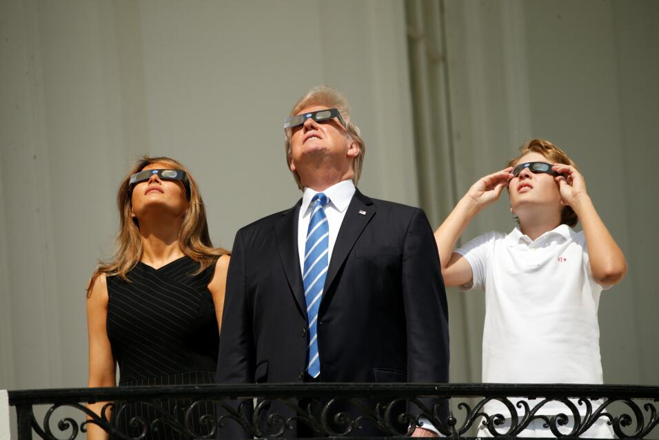 U.S. President Donald Trump watches the solar eclipse with first Lady Me...