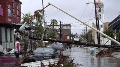 El impacto del huracán Odile que devastó al estado dejó caos y daños que...