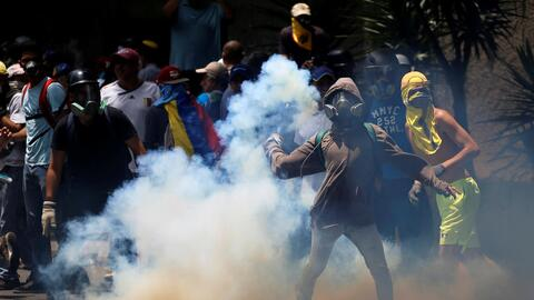 """A clash between protestors and anti-riot police in the so-called """"m..."""