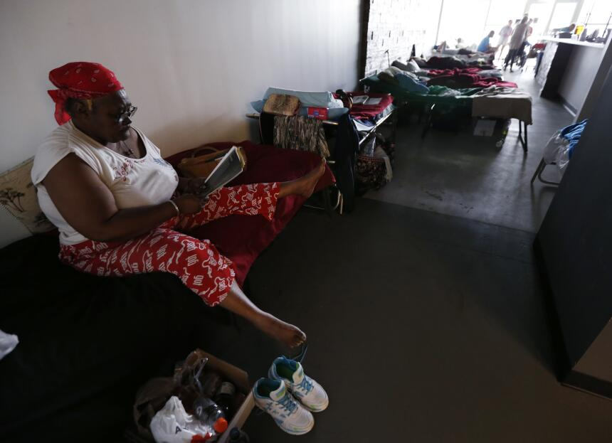Helen Haynes spends her time reading at a special needs shelter, Thursda...