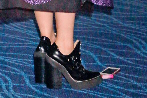 Y como era de esperarse, las zapatillas que eligió, también pecaban de e...