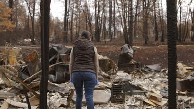 After the fire: a devastated Mexican mother gets to see what's left of her house in Paradise