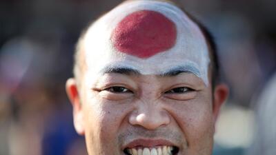 La alegría de los seguidores de Japón y Senegal en partido del grupo H del Mundial