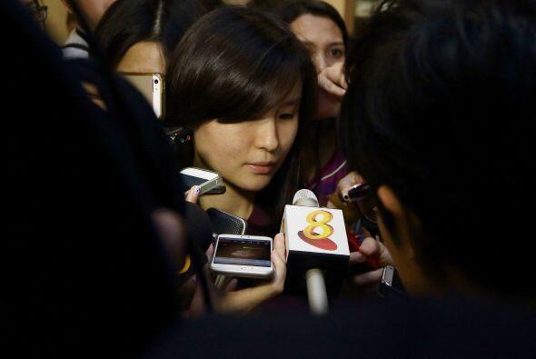 Esta mujer se encuentra en el aeropuerto Changi de Singapur, donde debía...