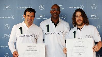 Luis Figo y Carles Puyol