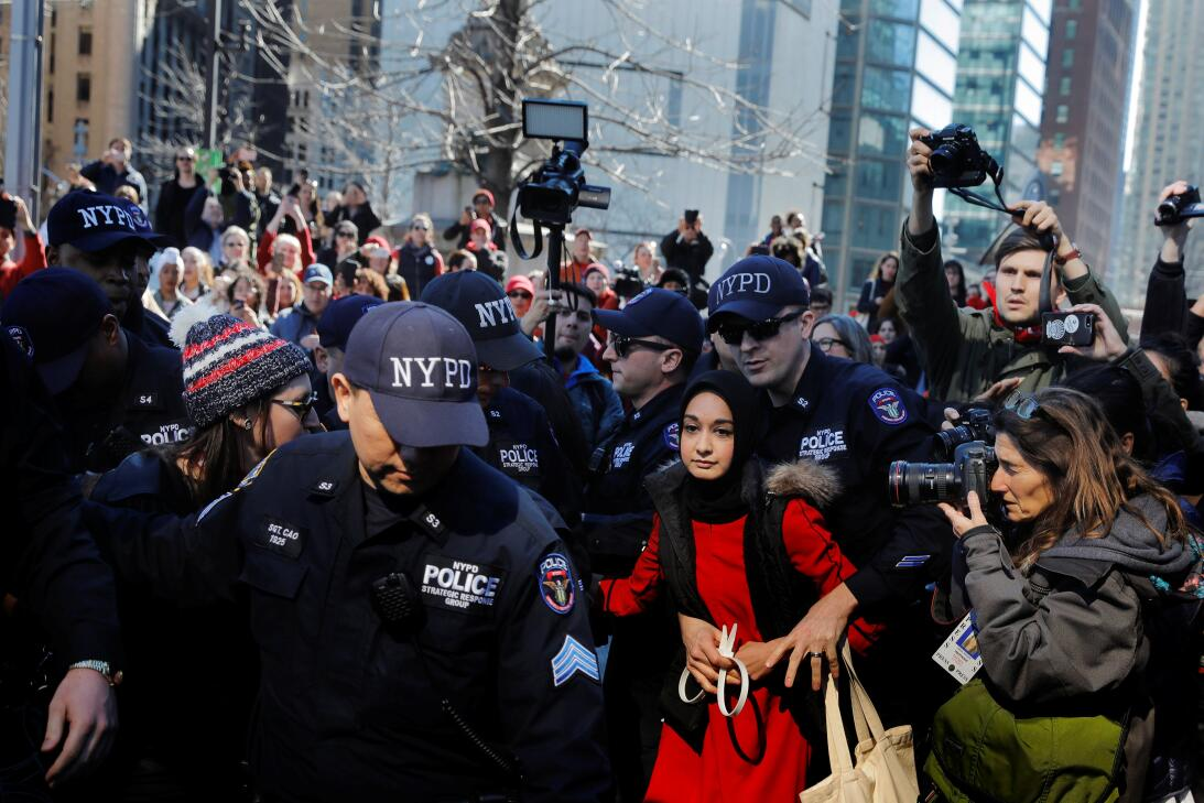 New York Police Department officers arrest a woman who was taking part i...
