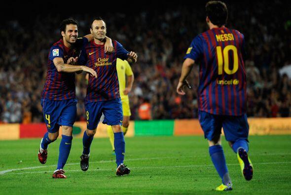 Aquí tanto Cesc como Iniesta agradecen a 'La Pulga'.