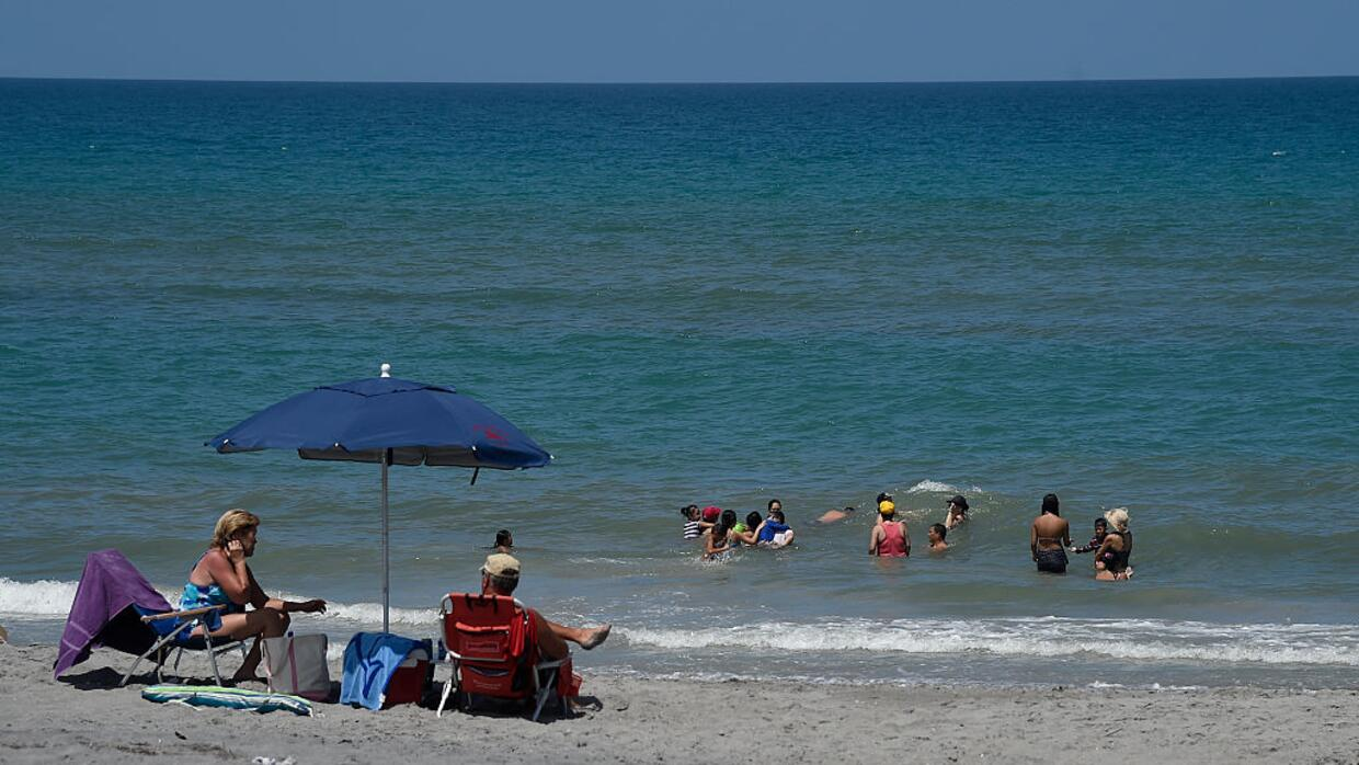 Hobe Sound Beach a day after a ban on swimming was lifted due to a blue-...