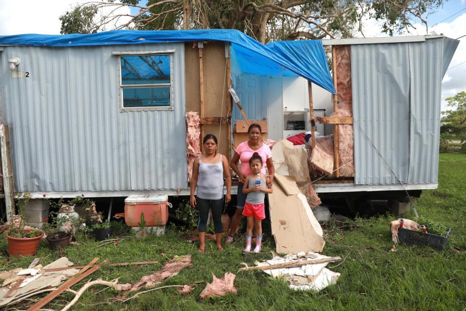 Sandra Guzman, left, with her daughter Maria Valentine Romero, right, an...