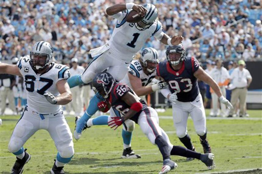 """Cam Newton voló como """"Superman"""" y con este brinco se coló al TD en el ju..."""
