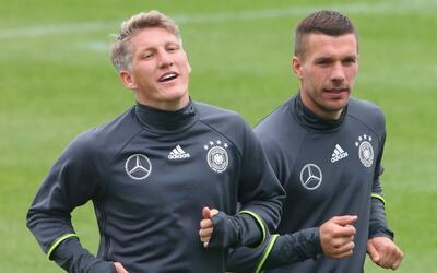 Bastian Schweisteiger y Lukas Podolski
