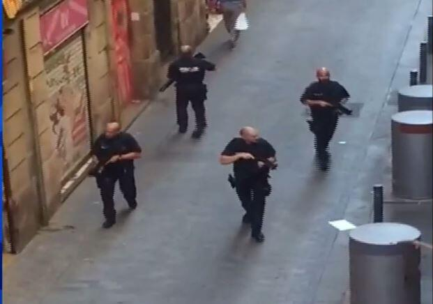 Armed police patrolled parts of Barcelona apparently looking for the att...