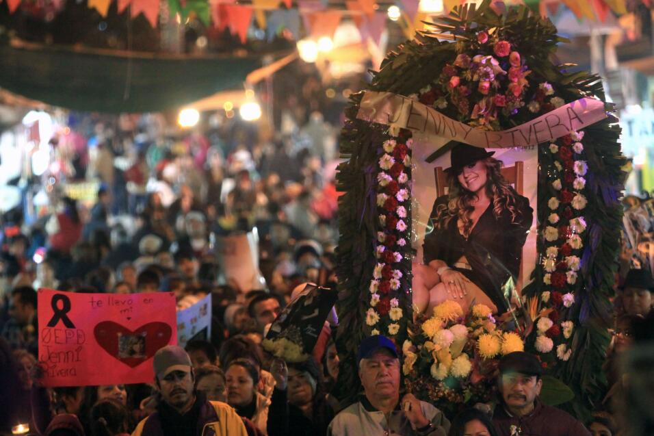 Fans of Mexican-US singer Jenni Rivera walk during a procession to the B...