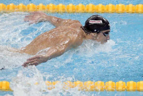 Michael Phelps se impuso en los 100 mariposa con 50.71 para obtener su t...