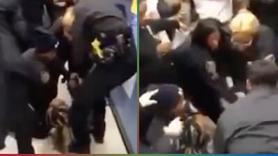 (Video) Policía arrebata agresivamente a un bebé de los brazos de su madre