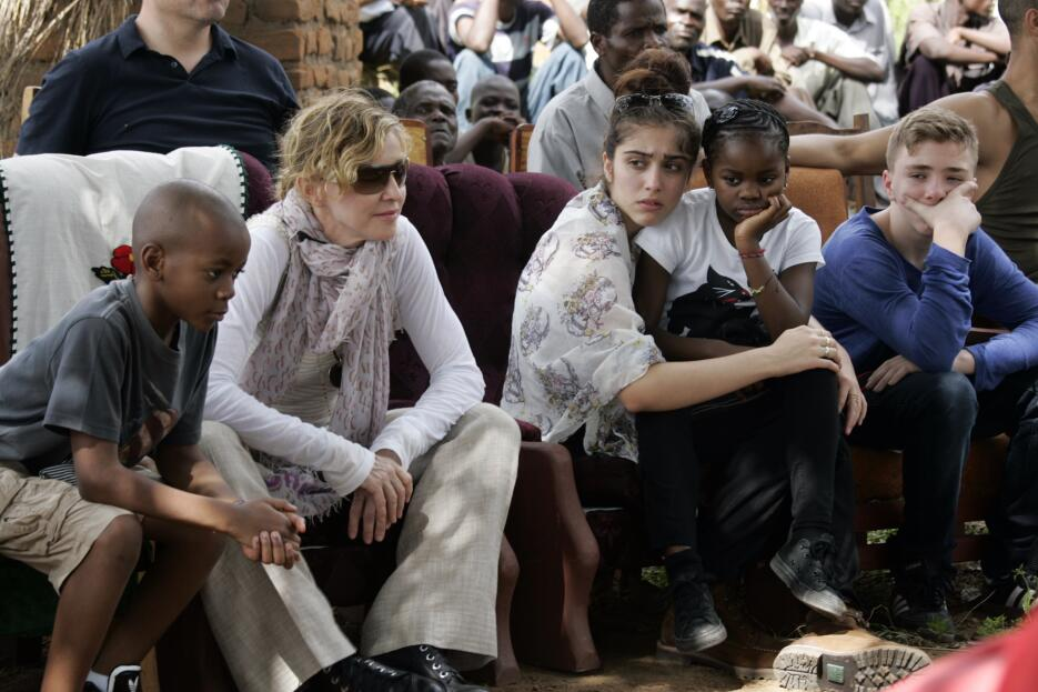US Pop Star Madonna (2nd L) sits with her biological and adopted childre...