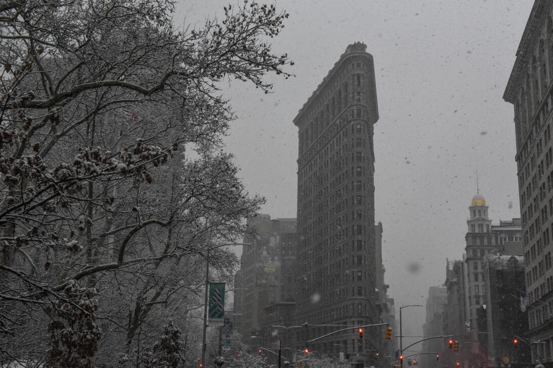 NEW YORK, NY - DECEMBER 09: The Flatiron building is seen in a snow stor...