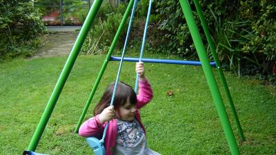 Kid falling off swing.