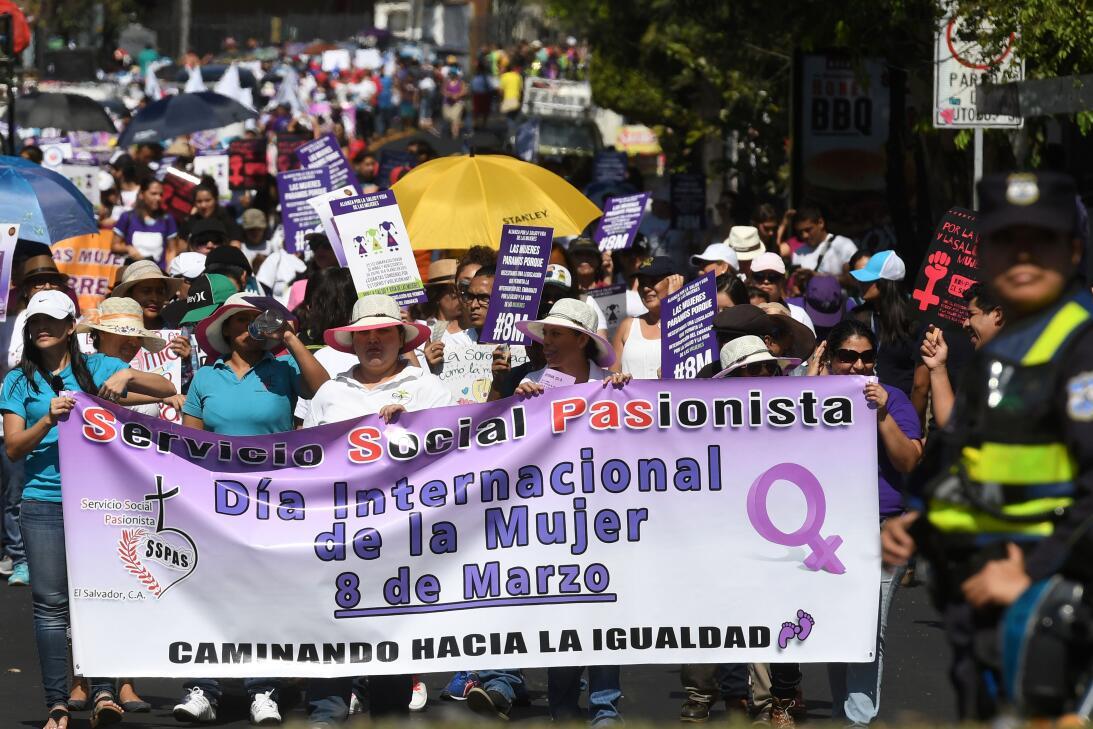 Women take part in a march to celebrate International Women's Day in...