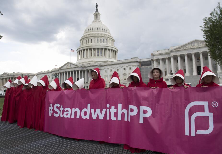 salud obamacare protestas mujeres rojo