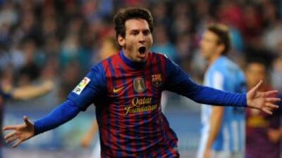 Lionel hizo tres goles a los malagueños... y pudieron ser más.