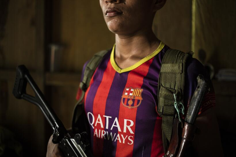 Guerrillas follow Europe's Champions League soccer on the radio in their...