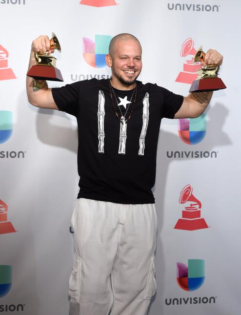 Residente poses in the press room during The 18th Annual Latin Grammy Aw...