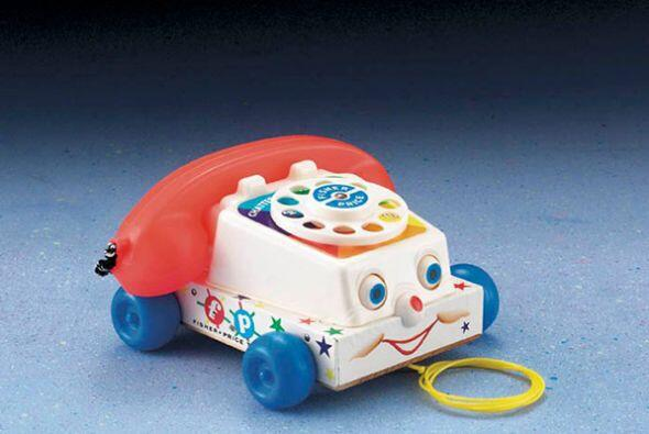 Teléfono. Este clásico juguete de la marca Fisher Price ayuda a los niño...