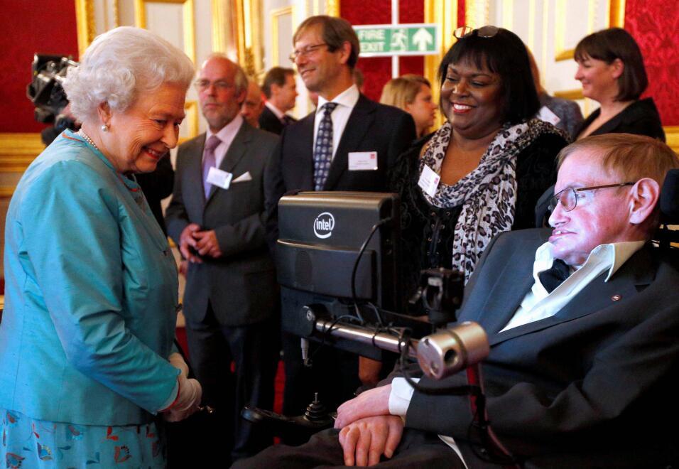 Junto a la reina Elizabeth, en Saint James Palace, en 2014.