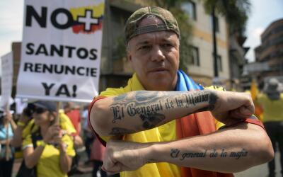 Alias Popeye durante una marcha organizada por partidarios del expreside...