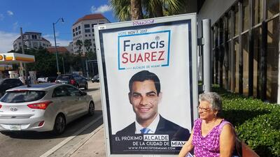 A bus billboard shows Miami mayoral candidate Francis Suárez in MIami&#3...