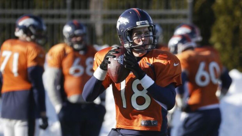 Peyton Manning ha brillado bajo el frío hasta ahora (AP-NFL).