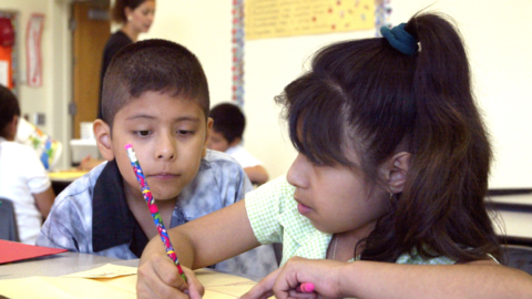Students work together in teacher Daisy Moran's second-grade bilingual c...