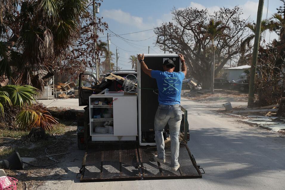 MARATHON, FL - SEPTEMBER 19:  Oni Ferreiro III throws items out as he cl...