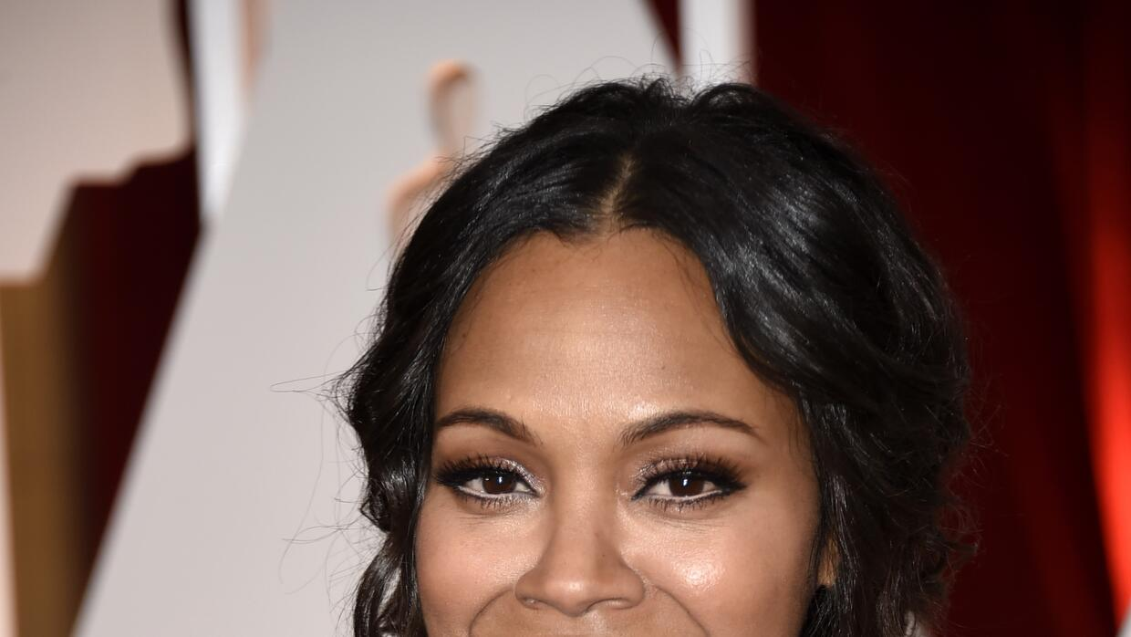 Actress Zoe Saldana attends the 87th Annual Academy Awards at Hollywood...