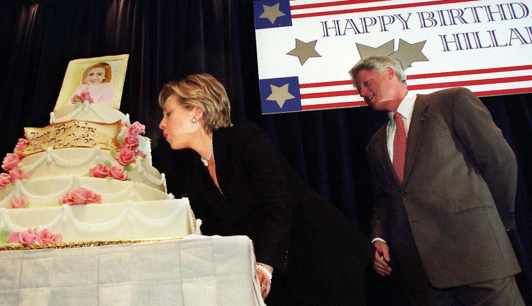 WASHINGTON, DC - OCTOBER 23:  First Lady Hillary Rodham Clinton blows ou...