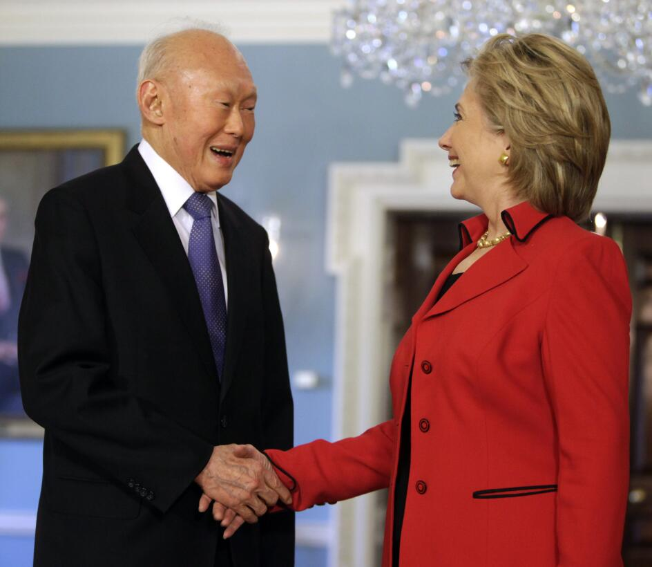 U.S. Secretary of State Hillary Clinton (R) shakes hands with Singapore&...