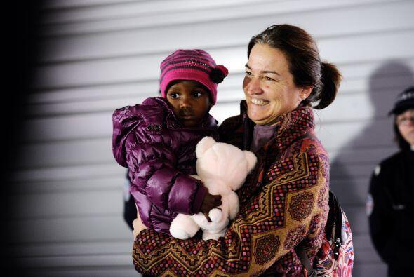 La mirada y sonrisa de esta madre francesa dice más que mil palabras al...