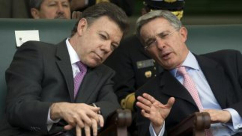Juan Manuel Santos y Álvaro Uribe.