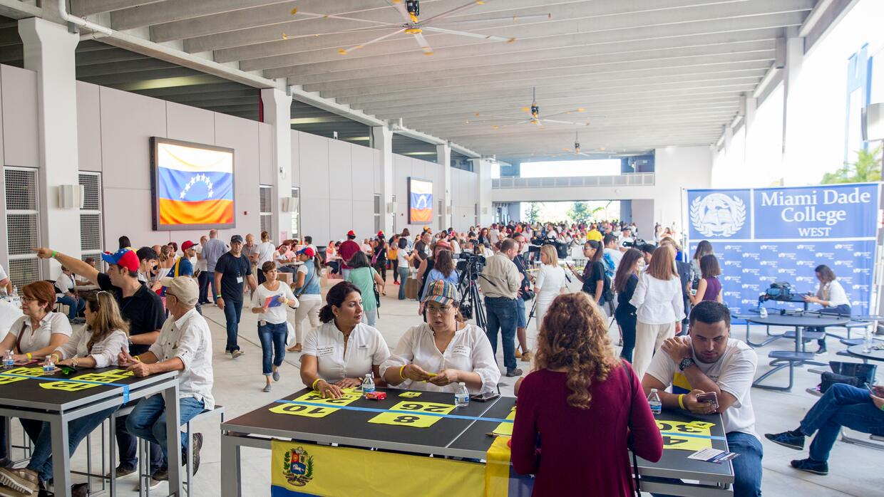 Venezuelans in Miami voted in record numbers Sunday. At seven polling lo...