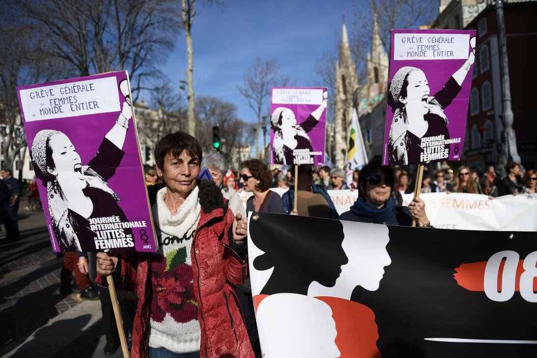 """Women hold banners reading """"General strike of all the world's w..."""